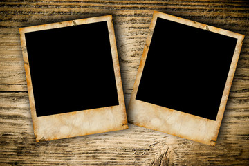 Grunge photo frames on wooden plank background