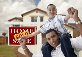 Hispanic Father and Son in Front of House, Sold Sign