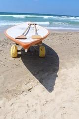 Lifeguard's Surfboard near the sea water