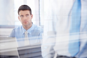 Casual office worker working in bright office