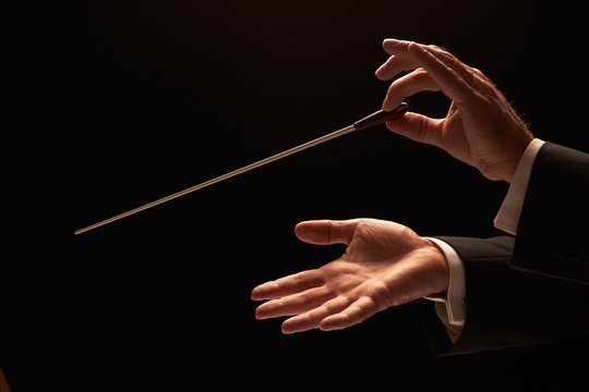 Conductor conducting an orchestra