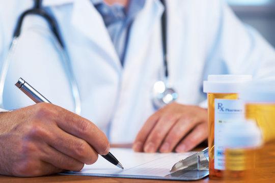Doctor writing RX prescription