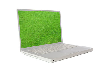 Laptop with the image of a green grass