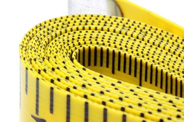 Close up shot of yellow measurement tape