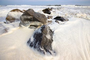 Foamy Surf on Rocks as Storm Approaches