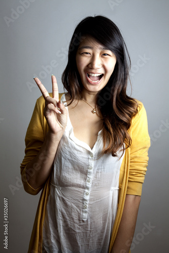 Asian peace signs