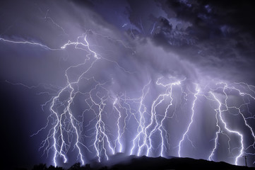 Photo sur cadre textile Tempete Lightning over the Rincon Mountains