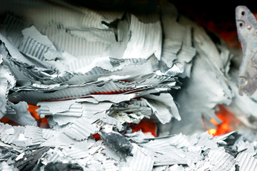 Paper burning in recycle barrel