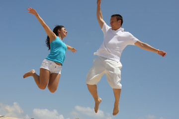 Young man and woman jumping