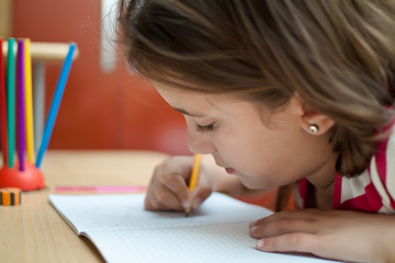 Small latin girl working on her homework