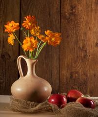 Orange flowers and apples