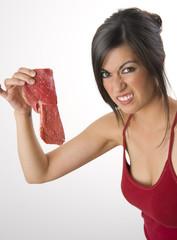 Beautiful Brunette holds raw red steak meat