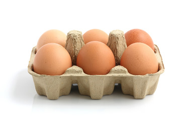 eggs in the package isolated in white background