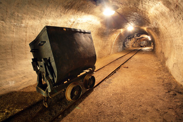 Fototapete - Underground train in gold, silver and copper mine.