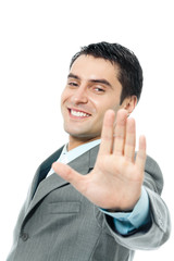 Businessman with stop gesture, over white