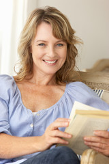 Mid age woman reading a book