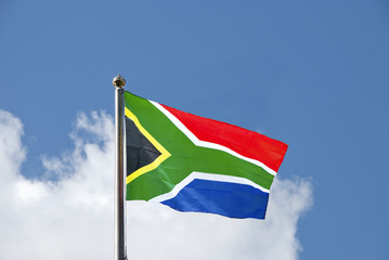 South African Flag on a flagpole against a blue sky