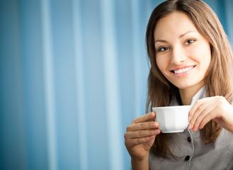Portrait of businesswoman drinking coffee