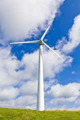 Wind turbine over blue sky