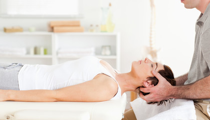 Chiropractor stretching a cute woman