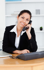 Smiling businesswoman on telephone