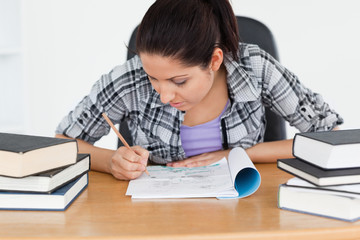 Young student writing into her exercise book