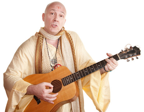 Guru Plays a Guitar