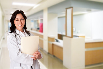 Happy Doctor with patient chart file dossier in hospital