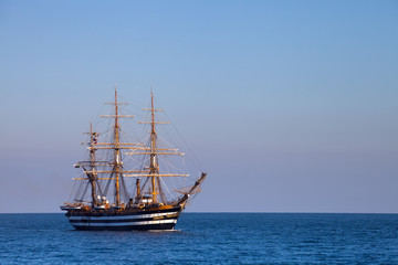A beautiful three-masted sailboat in the sea