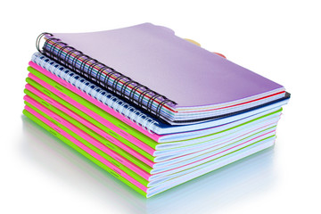 Green and pink notebooks isolated on white