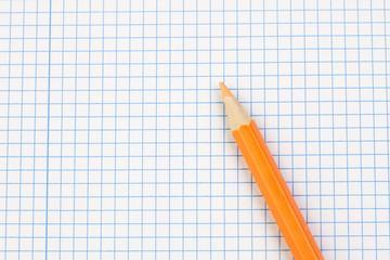 Sharp pencil on a notebook