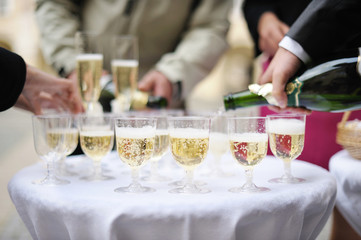 Pouring champagne into a glasses on a festive event