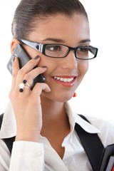 Beautiful businesswoman on mobile phone smiling