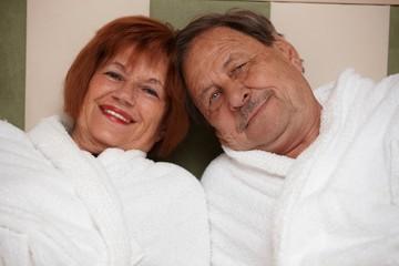Happy elderly couple in bathrobe