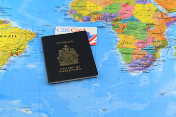 Canadian passport with care card on the global map