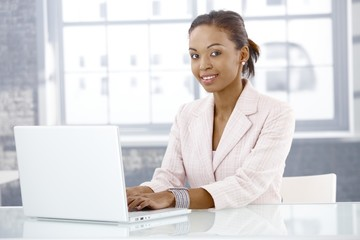 Afro businesswoman using laptop