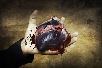 Halloween concept. heart in hand with blood