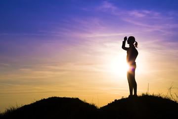 Tourist woman at sunset.