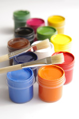 gouache of paint and brush on white background