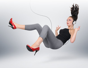 Young girl with headphones in unreal pose