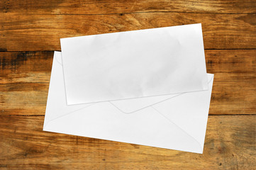 Vintage Envelope with blank Brown paper on wood