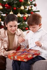 Mother and son opening presents