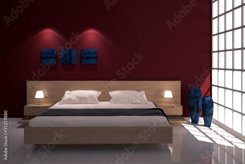 Camera da letto con finestra e parete rossa\