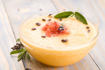 fresh melon soup with parma ham and lavender flower
