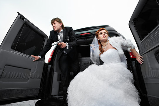 Bride and groom playing gangsters