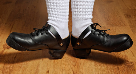 feet in step shoes and white socks