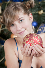 Merry Christmas - Young girl with Christmas decoration