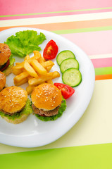 Plate with tasty mini burgers