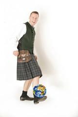 Schotte mit Weltkugel