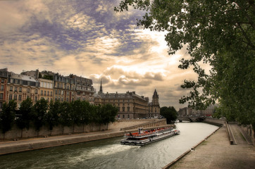 Touristic boat on Seine river in Paris, France.